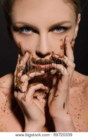 Beautiful Woman With Chocolate On Her Face