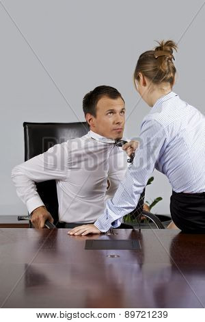 Businesswoman flirting with businessman at office