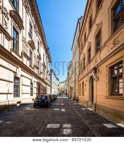Narrow Empty Street With Parked Cars In Krakow, Poland.
