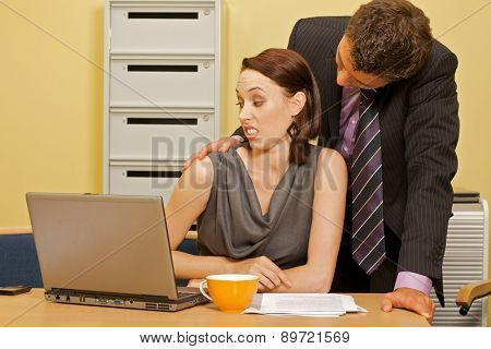 Businessman flirting with businesswoman in office