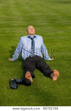 Businessman relaxing in park