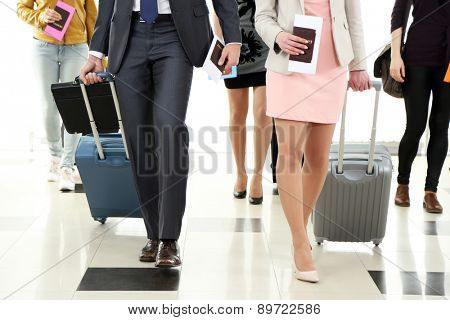 People with suitcases in airport