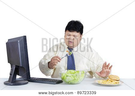 Overweight Businessman Avoid Junk Food 1