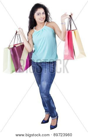 Model With Curly Hair And Shopping Bags
