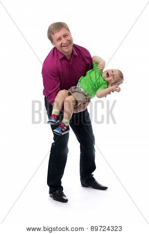 Portrait Of A Father And Three Year Old Son In Her Arms In The Studio.