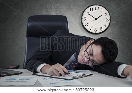 Manager Sleeping With Clock On The Wall