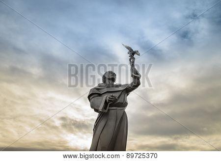 Saint Francis statue holding a dov