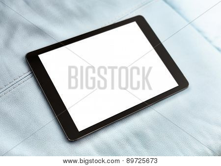 Tablet on blue leather closeup. With shallow DOF.