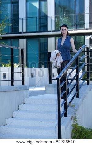 Portrait of businesswoman walking down stairs