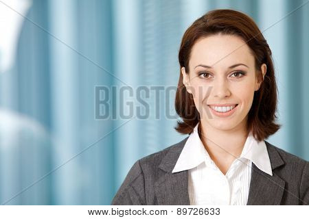 Portrait of young caucasian businesswoman in office