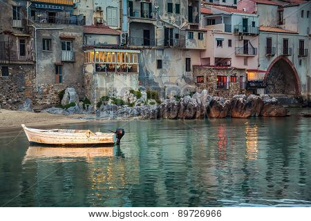 Old Small Boat In The Harbor Of Cefalu