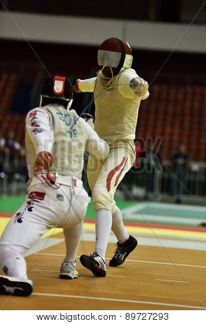 ST. PETERSBURG, RUSSIA - MAY 2, 2015: Young Ki Son of Korea vs Johannes Poscharnig of Austria in 1/64 final of International fencing tournament St. Petersburg Foil, the stage of FIE World Cup