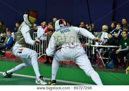 ST. PETERSBURG, RUSSIA - MAY 2, 2015: Dmitry Rigin of Russia vs Georg Doerr of Germany in 1/64 final of International fencing tournament St. Petersburg Foil. The tournament is the stage of World Cup