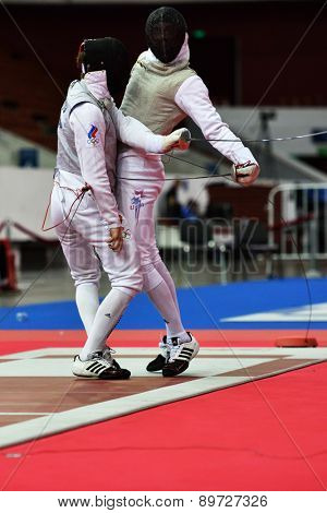 ST. PETERSBURG, RUSSIA - MAY 2, 2015: Roman Kuts of Russia (left) vs Race Imboden of USA in 1/64 final of International fencing tournament St. Petersburg Foil. The tournament is the stage of World Cup