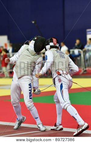 ST. PETERSBURG, RUSSIA - MAY 2, 2015: Baptiste Mourrain of France vs Edoardo Luperi of Italy in 1/64 final of International fencing tournament St. Petersburg Foil, the stage of FIE World Cup