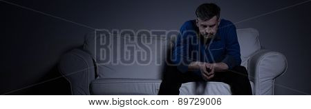 Lonely Man Sitting On The Sofa