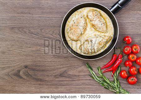 Chicken breast in cream sauce.
