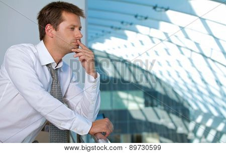 Businessman contemplating