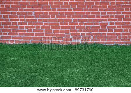 Lawn Of Grass And Brick Wall