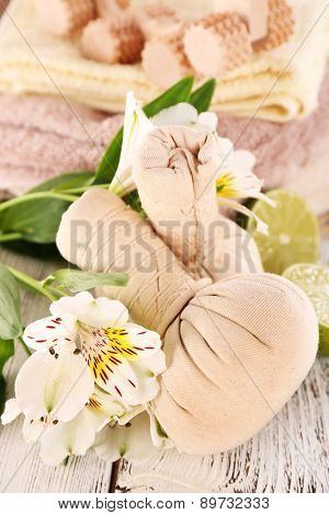 Spa still life with flower and lime on wooden table, closeup