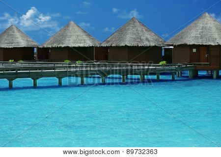 Water villas over ocean background
