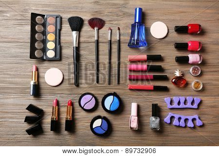 Various cosmetics on wooden background
