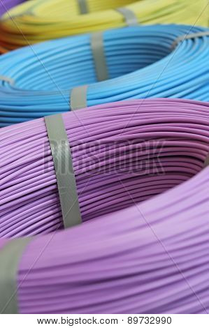 Hanks of multi-colored cords in the coils