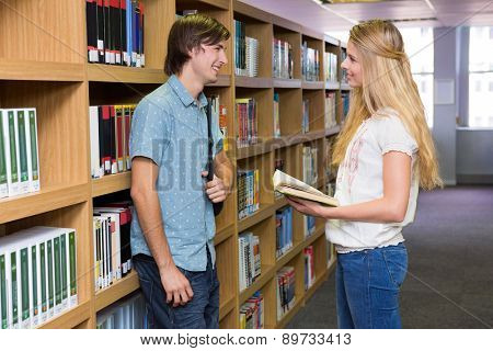 Students discussing in the library at the university