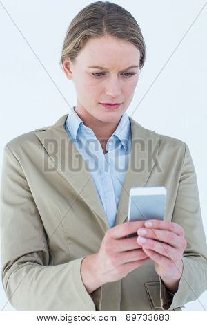 Businesswoman using her mobile phone on white background