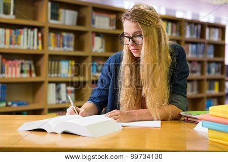 Student studying in the library at the university