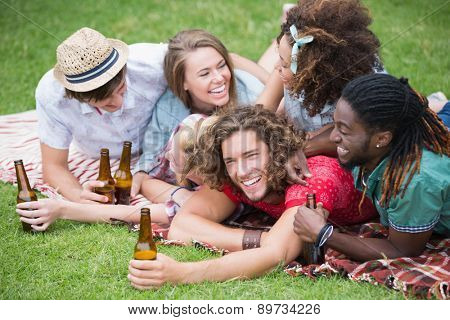 Hipster friends drinking beer and laughing on a sunny day