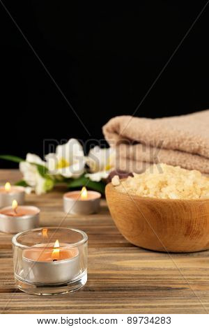 Spa still life on wooden table on black background