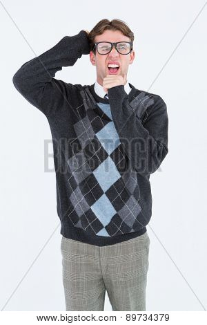 Geeky hipster frowning at camera on white background