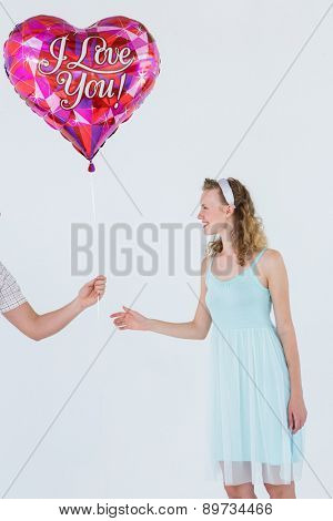 Hipster woman having heart balloon on white background