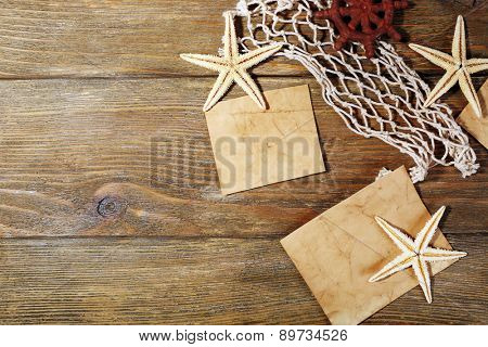 Card blanks with sea stars on wooden background