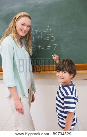 Teacher explaining mathematics to a pupil at elementary school