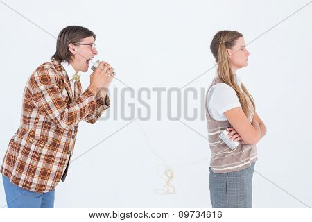 Geeky hipsters using string phone on white background
