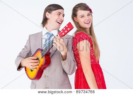 Hipster couple having fun together on white background