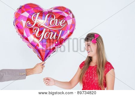 Geeky hipster offering red heart shape balloon to his girlfriend on white background