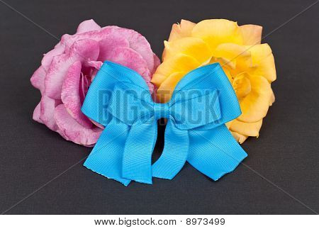 Blue Charity Ribbon And Roses
