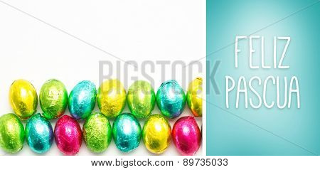 Feliz pascua against blue vignette background