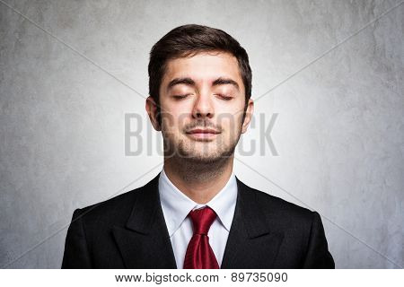 Portrait of a relaxed businessman with closed eyes