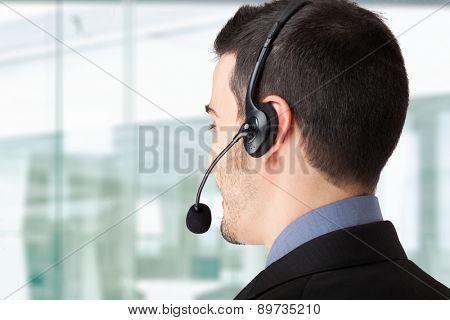 Portrait of a businessman using an headset