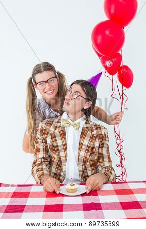 Geeky hipsters celebrating birthday on white background