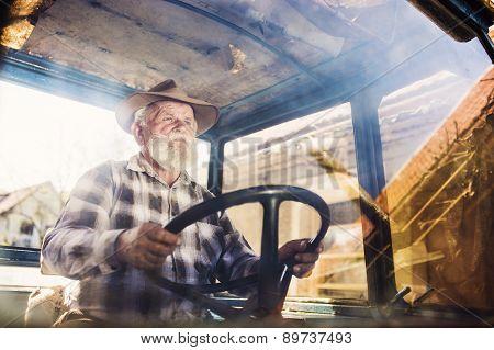 Senior farmer on a tractor