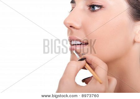 Woman Applying Lip Gloss With Brush