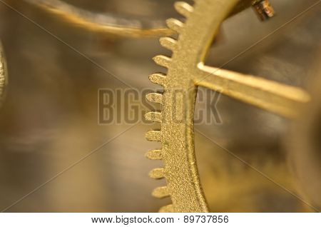 Gold Cogwheels In Old Clockwork. Macro