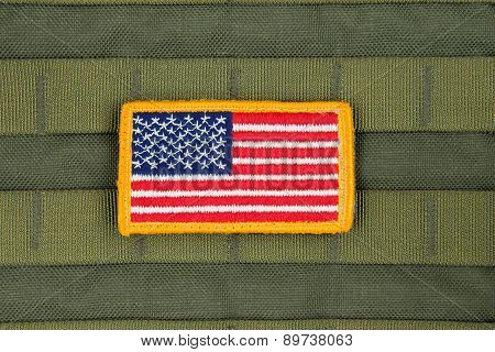 Rounded American flag patch on U.S. military combat uniform,OD Color.
