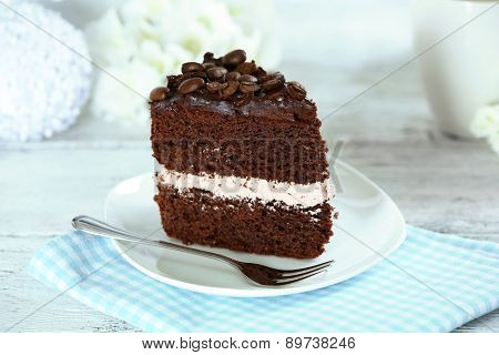 Delicious chocolate cake on table on light background