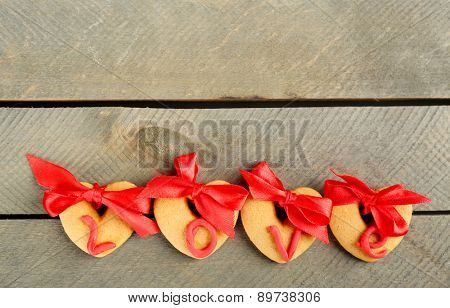 Heart shaped cookies for valentines day on color background